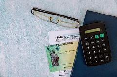 Recovery rebate credit stimulus check with tax form.